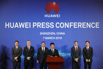 In this March 7, 2019, photo, Huawei Rotating Chairman Guo Ping, center, speaks in front of other executives during a press conference in Shenzhen city, China's Guangdong province. Chinese tech giant Huawei is launching a U.S. court challenge to a law that labels the company a security risk and would limit its access to the American market for telecom equipment. (AP Photo/Kin Cheung, File)