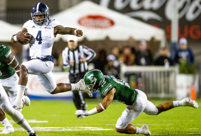 Georgia Southern quarterback Shai Werts (4) breaks free for a long gain against Eastern Michigan defensive back Justin Moody (13) during first-half NCAA college football action in the Camellia Bowl in Montgomery, Ala., Saturday, Dec. 15, 2018. (Mickey Welsh/The Montgomery Advertiser via AP)