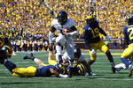 Army quarterback Kelvin Hopkins Jr. (8) scores on a six-yard run in overtime of an NCAA college football game against Michigan in Ann Arbor, Mich., Saturday, Sept. 7, 2019. Michigan won 24-21. (AP Photo/Paul Sancya)