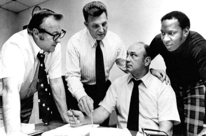 File-This Jan. 29, 1975, file photo shows Coach Lou Saban (second from left) of the Buffalo Bills, discussing with his staff one of their choices in Philadelphia in the three-day National Football League draft of college seniors. From left are: Bills' chief scout Bob Celeri; Saban; personnel director Harvey Johnson and scout Elbert Dubenion.  Dubenion, who played key roles in the Buffalo Bills winning consecutive American Football League championships in the mid-1960s, has died. He was 86. The Bills announced Dubenion died Thursday, 55 years to the day of Buffalo winning its first AFL title with a 20-7 victory over the San Diego Chargers. Dubenion was living in Ohio and had been battling Parkinson's disease and Alzheimer's. (AP Photo/Bill Ingraham, File)
