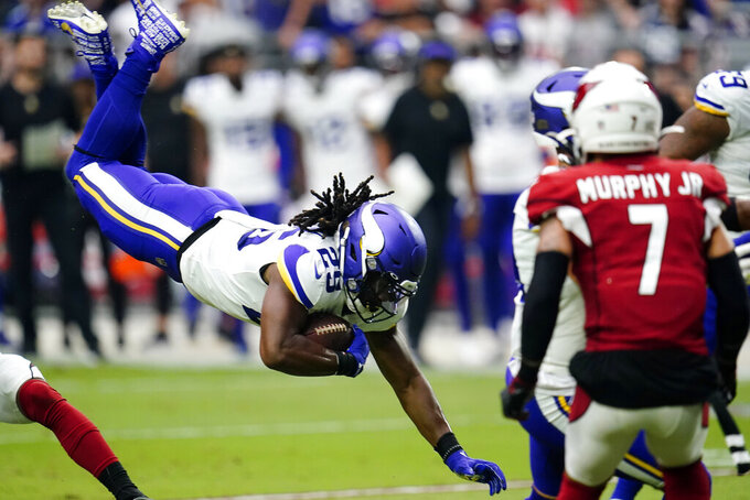 Minnesota Vikings defensive back Kris Boyd (29) dives for a first down against the Arizona Cardinals during the first half of an NFL football game, Sunday, Sept. 19, 2021, in Glendale, Ariz. (AP Photo/Ross D. Franklin)