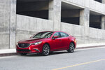 This photo provided by Mazda shows the 2017 Mazda 6, a midsize sedan that's available with a manual transmission. The Mazda 6 is definitely worth a look for buyers interested in a comfortable, stylish sedan with three pedals. (Morgan J Segal/Courtesy Mazda North American Operations via AP)