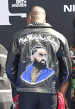 Rapper YG wears a jacket in honor of Nipsey Hussle as he arrives at the BET Awards on Sunday, June 23, 2019, at the Microsoft Theater in Los Angeles. (Photo by Richard Shotwell/Invision/AP)