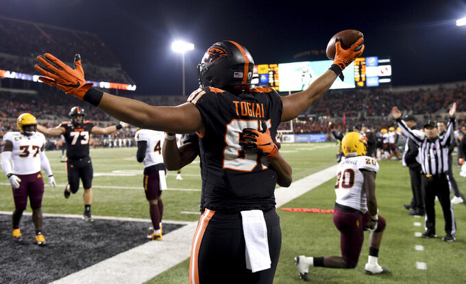 Oregon State tight end Noah Togiai celebrates after scoring a touchdown during the second half of an NCAA college football game against Arizona State in Corvallis, Ore., Saturday, Nov. 16, 2019. (AP Photo/Steve Dykes)
