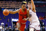Dayton guard Ibi Watson (2) drives to the basket around the defense of Saint Mary's guard Tanner Krebs during the first half of an NCAA college basketball game, Sunday, Dec. 8, 2019, in Phoenix. (AP Photo/Ralph Freso)
