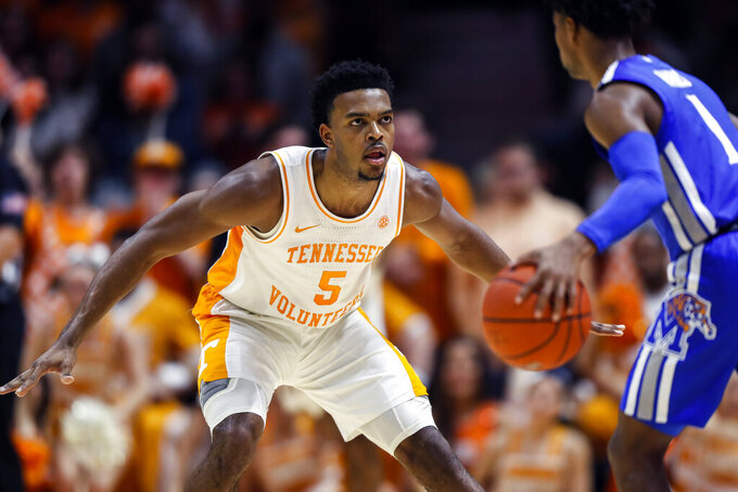 Tennessee guard Josiah-Jordan James (5) defends against Memphis guard Tyler Harris (1) during the first half of an NCAA college basketball game Saturday, Dec. 14, 2019, in Knoxville, Tenn. (AP Photo/Wade Payne)