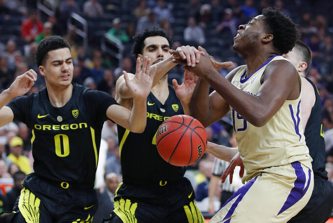 Oregon rolls over Washington 68-48 to win Pac-12 title
