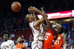 Syracuse's Elijah Hughes (33) fouls Boston College's Steffon Mitchell (41) during the first half of an NCAA college basketball game, Tuesday, March, 3, 2020, in Boston. (AP Photo/Michael Dwyer)