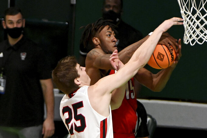 North Carolina State forward Manny Bates (15) goes after a rebound with Davidson forward Bates Jones (25) in the first half of an NCAA college basketball game in the first round of the NIT, Thursday, March 18, 2021, in Denton, Texas. (AP Photo/Matt Strasen)