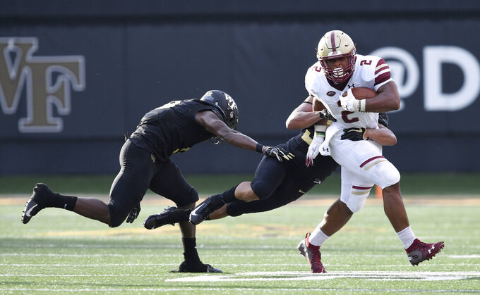 Boston College running back AJ Dillon (2) runs through Wake Forest tacklers during the first half of an NCAA college football game, Thursday, Sept. 13, 2018, in Winston-Salem, N.C. (AP Photo/Woody Marshall)
