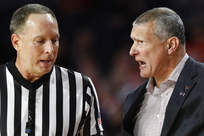 South Carolina's Frank Martin speaks with the referee  during an NCAA college basketball game against Georgia  in Athens, Ga., on Saturday, Feb. 2, 2019.  (Joshua L. Jones/Athens Banner-Herald via AP)