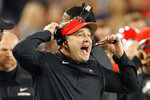 FILE - In this Nov. 17, 2018, file photo, Georgia head coach Kirby Smart reacts on the sideline during the second half of an NCAA college football game against Massachusetts in Athens, Ga. Notre Dame and Georgia. Two of college football's most storied programs meet for the first time in one of its most famed settings, a game that already feels special because of its historic ramifications but is also likely to have a huge impact on this year's race to the College Football Playoff.  (AP Photo/John Bazemore, File)