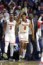 Texas Tech's Kyler Edwards (0) celebrates after making a 3-point basket as teammate Deshawn Corprew (3) cheers during the second half of a second round men's college basketball game against Buffalo in the NCAA Tournament Sunday, March 24, 2019, in Tulsa, Okla. (AP Photo/Jeff Roberson)