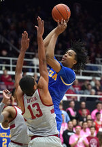 UCLA center Moses Brown (1) shoots over Stanford forward Oscar da Silva (13) during the first half of an NCAA college basketball game Saturday, Feb. 16, 2019, in Stanford, Calif. (AP Photo/Tony Avelar)