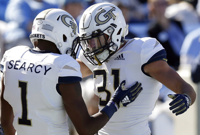 Georgia Tech's Qua Searcy (1) congratulates Nathan Cottrell (31) following Cottrell's touchdown against North Carolina during the first half of an NCAA college football game in Chapel Hill, N.C., Saturday, Nov. 3, 2018. (AP Photo/Gerry Broome)