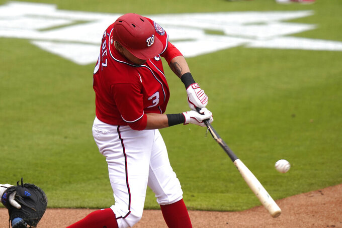 Washington Nationals Hernan Perez hits an RBI single to score Carter Kieboom and Luis Garcia during the sixth inning of a spring training baseball game against the New York Mets, Monday, March 8, 2021, in West Palm Beach, Fla. (AP Photo/Lynne Sladky)