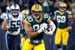 Bew FILE - In this Nov. 11, 2019, file photo, Green Bay Packers tight end Jimmy Graham runs after making a catch during an NFL football game against the Carolina Panthers in Green Bay, Wis. The Chicago Bears have finalized a two-year contract with Graham on Thursday, March 26, 2020. (AP Photo/Matt Ludtke, File)