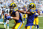 Los Angeles Rams wide receiver Robert Woods (17) congratulates tight end Tyler Higbee (89) following Higbee's touchdown against the Carolina Panthers during the second half of an NFL football game in Charlotte, N.C., Sunday, Sept. 8, 2019. (AP Photo/Mike McCarn)