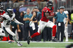 Atlanta Falcons wide receiver Julio Jones (11) runs toward the end zone for a touchdown against Philadelphia Eagles free safety Rodney McLeod (23) during the second half of an NFL football game, Sunday, Sept. 15, 2019, in Atlanta. (AP Photo/John Bazemore)