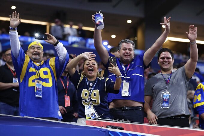 Fans cheer before the NFL Super Bowl 53 football game between the Los Angeles Rams and the New England Patriots Sunday, Feb. 3, 2019, in Atlanta. (AP Photo/Carolyn Kaster)