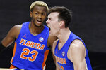 Florida's Colin Castleton reacts next to Scottie Lewis (23) after making a basket while fouled during the first half of the team's NCAA college basketball game against Boston College, Thursday, Dec. 3, 2020, in Uncasville, Conn. (AP Photo/Jessica Hill)