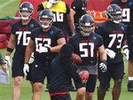 Atlanta Falcons offensive lineman tackle Kaleb McGary, from left,  guard Chris Lindstrom , center Alex Mack, and tackle Matt Gono take the line during an NFL football training camp practice Saturday, Aug. 15, 2020, in Flowery Branch, Ga.  (Curtis Compton/Atlanta Journal-Constitution via AP)