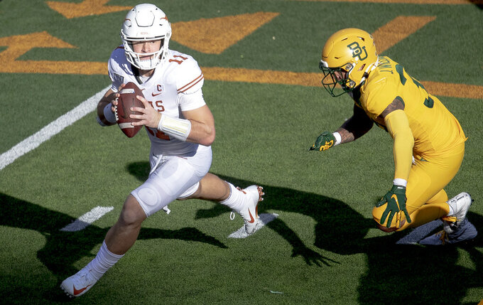 Texas quarterback Sam Ehlinger (11) tries to evade Baylor linebacker Jordan Williams (38) during an NCAA college football game on Saturday, Nov. 23, 2019, in Waco, Texas. (Nick Wagner/Austin American-Statesman via AP)