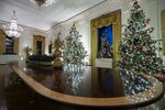 The East Room is decorated during the 2019 Christmas preview at the White House, Monday, Dec. 2, 2019, in Washington. (AP Photo/Alex Brandon)