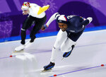 Shani Davis of the U.S., right, and Bart Swings of Belgium compete during the men's 1,500 meters speedskating race at the Gangneung Oval at the 2018 Winter Olympics in Gangneung, South Korea, Tuesday, Feb. 13, 2018. (AP Photo/Vadim Ghirda)