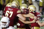 Boston College's Aaron Boumerhi, center, celebrates his go-ahead field goal in the closing seconds of the team's NCAA college football game against Texas State, Saturday, Sept. 26, 2020, in Boston. (AP Photo/Michael Dwyer)