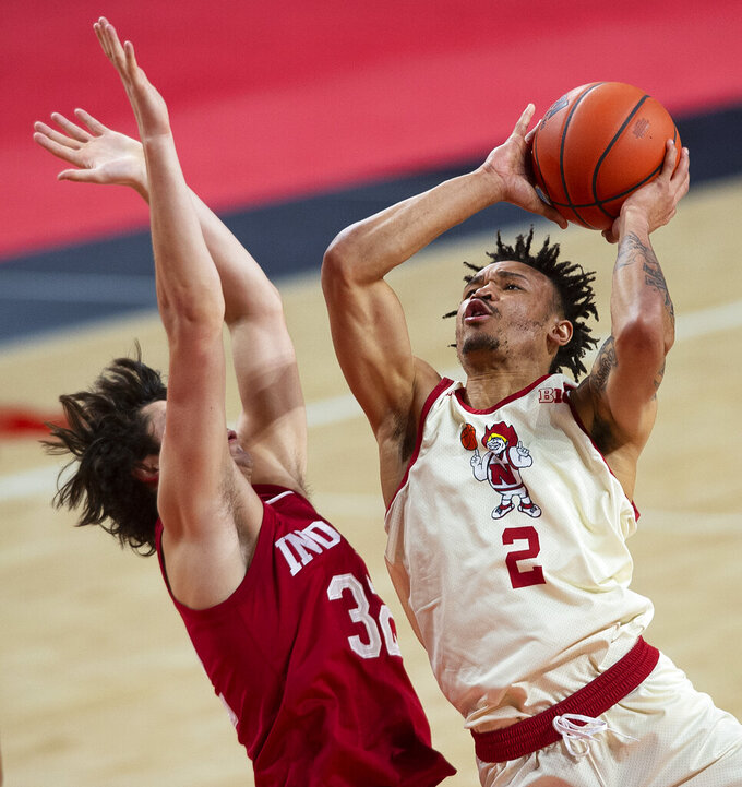 Nebraska's Trey McGowens scores against Indiana's Trey Galloway in the first half of an NCAA college basketball game on Sunday, Jan. 10, 2021. (Kenneth Ferriera/Lincoln Journal Star via AP)