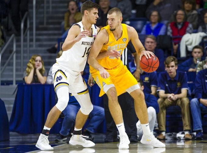 Toledo's Luke Knapke (30) works against Notre Dame's Nate Laszewski (14) during an NCAA college basketball game Thursday, Nov. 21, 2019, in South Bend, Ind. (Michael Caterina/South Bend Tribune via AP)