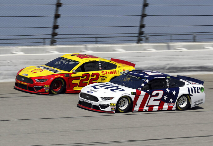 Joey Logano, left, and Brad Keselowski drive during a practice for the NASCAR Sprint Cup Series auto race at Chicagoland Speedway in Joliet, Ill., Saturday, June 29, 2018. (AP Photo/Nam Y. Huh)