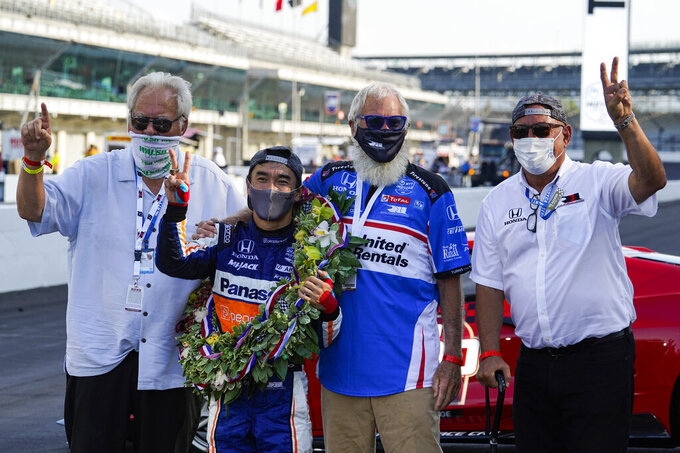 Takuma Sato, left center, of Japan, celebrates with car owners Michael Lanigan, left, David Letterman, center right, and Bobby Rahal after winning the Indianapolis 500 auto race at Indianapolis Motor Speedway in Indianapolis, Sunday, Aug. 23, 2020. (AP Photo/Michael Conroy)