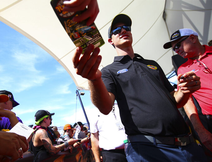 Joey Logano greets fans before a NASCAR Cup Series auto race at the Las Vegas Motor Speedway on Sunday, Sept. 15, 2019. (AP Photo/Chase Stevens)