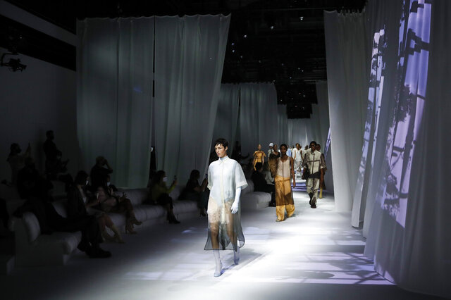 Models wear creations as part of the Fendi 2021 women's spring-summer ready-to-wear collection during the Milan's fashion week in Milan, Italy, Wednesday, Sept. 23, 2020. (AP Photo/Antonio Calanni)