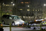 FILE - In this April 10, 2018 file photo, a minivan is removed from the parking lot near the Seven Hills School campus in Cincinnati. Kyle Plush, a 16-year-old student, died in the vehicle after being trapped by a fold-up seat despite making two 911 calls. On Wednesday, Jan. 22, 2020, an Ohio judge will rule on whether to move forward with a lawsuit filed by the family of Plush. The suit, filed last year, charges the city, a former city official and four city employees with actions it alleges led to Plush's 2018 death. (Cara Owsley/The Cincinnati Enquirer via AP, File)