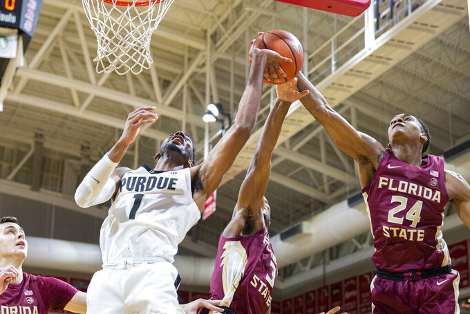Florida State guard Devin Vassell (24) and guard Trent Forrest (3) block the shot of Purdue forward Aaron Wheeler (1) in the first half of an NCAA college basketball game at the Emerald Coast Classic in Niceville, Fla., Saturday, Nov. 30, 2019. (AP Photo/Mark Wallheiser)
