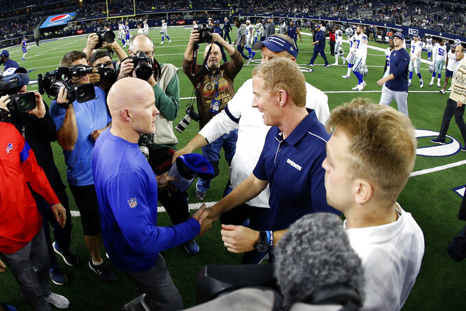 Buffalo Bills head coach Sean McDermott, left, and Dallas Cowboys head coach Jason Garrett, center right, greet each other after their NFL football game in Arlington, Texas, Thursday, Nov. 28, 2019. (AP Photo/Ron Jenkins)