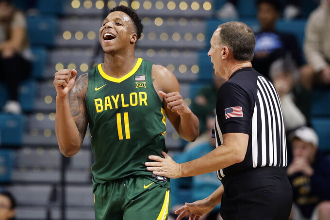 Baylor guard Mark Vital (11) reacts during the first half of an NCAA college basketball game against Coastal Carolina at the Myrtle Beach Invitational in Conway, S.C., Friday, Nov. 22, 2019. (AP Photo/Gerry Broome)