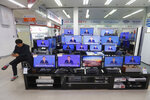 TV screens show the live broadcast of South Korean President Moon Jae-in's New Year press conference at the Yongsan Electronic store in Seoul, South Korea, Tuesday, Jan. 14, 2020. Moon said Tuesday he could push for exemptions of U.N. sanctions placed on North Korea as a way to promote an expansion of inter-Korean ties that he says would help restart nuclear negotiations between Pyongyang and Washington. (AP Photo/Ahn Young-joon)