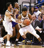 Missouri's Torrence Watson, right, grabs the ball from teammate Jordan Geist, left, as LSU's Ja'vonte Smart, center, tries to break it up during the first half of an NCAA college basketball game Saturday, Jan. 26, 2019, in Columbia, Mo. (AP Photo/L.G. Patterson)
