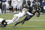 Vanderbilt running back Ke'Shawn Vaughn (5) is stopped by ETSU defensive back Artevius Smith (26) in the first half of an NCAA college football game Saturday, Nov. 23, 2019, in Nashville, Tenn. (AP Photo/Mark Humphrey)