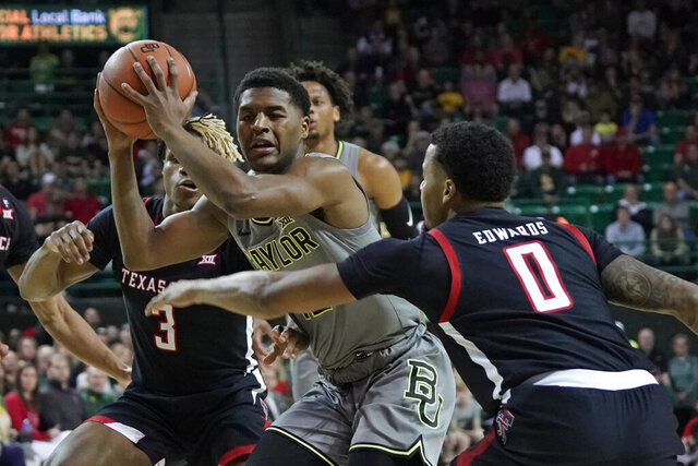 Baylor's Jared Butler, center, is trapped by Texas Tech's Kyler Edwards (0) and Jahmi'us Ramsey (3) during the first half of an NCAA college basketball game in Waco, Texas, Monday, March 2, 2020. (AP Photo/Chuck Burton)