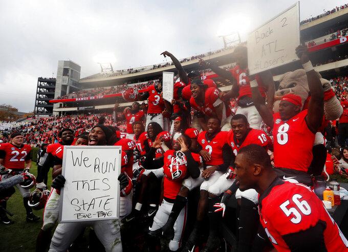 Georgia players celebrate after defeating Georgia Tech 45-21 in an NCAA college football game Saturday, Nov. 24, 2018, in Athens, Ga. (AP Photo/John Bazemore)