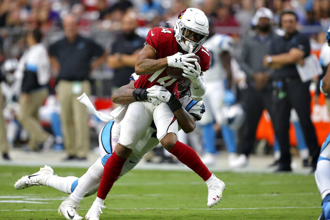 Arizona Cardinals wide receiver Damiere Byrd (14) is hit by Carolina Panthers outside linebacker Shaq Thompson during the second half of an NFL football game, Sunday, Sept. 22, 2019, in Glendale, Ariz. (AP Photo/Ross D. Franklin)