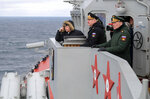 Russian President Vladimir Putin, left, Commander-in-Chief of the Russian Navy Nikolai Yevmenov, second right, and Commander of the Southern Military District troops Alexander Dvornikov, right, watch a navy exercise from the Marshal Ustinov missile cruiser in the Black Sea, Crimea, Thursday, Jan. 9, 2020. The drills involved warships and aircraft that launched missiles at practice targets. (Alexei Druzhinin, Sputnik, Kremlin Pool Photo via AP)