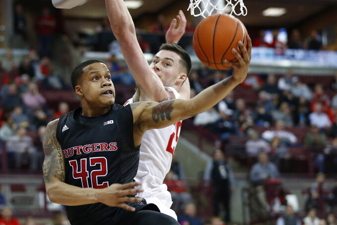 Rutgers' Jacob Young, (42) shoots past Ohio State's Kyle Young during the first half of an NCAA college basketball game Wednesday, Feb. 12, 2020, in Columbus, Ohio. (AP Photo/Jay LaPrete)