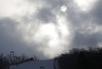 The sun shines through clouds at the women's slalom at Yongpyong alpine center at the 2018 Winter Olympics in Pyeongchang, South Korea, Wednesday, Feb. 14, 2018. (AP Photo/Christophe Ena)