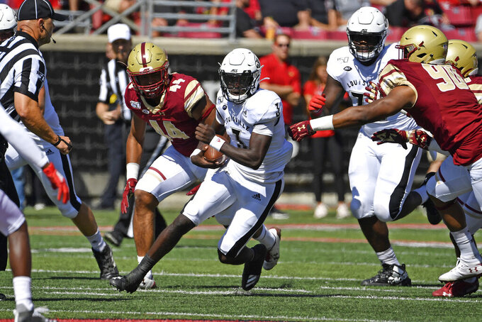 CORRECTS FIRST NAME TO MICALE, NOT MALIK - Louisville quarterback Micale Cunningham (3) runs through an opening in the Boston College defense during the first half of an NCAA college football game in Louisville, Ky., Saturday, Oct. 5, 2019. (AP Photo/Timothy D. Easley)